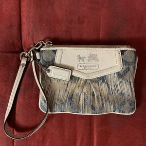 COACH women's wristlet handbag.